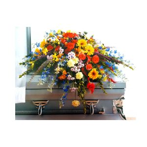 Colorful casket spray Nick's Greenhouse
